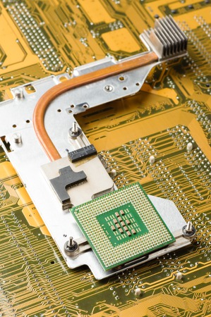 computer chip: Central Processing Unit (CPU) on heatsink (cooler) Stock Photo