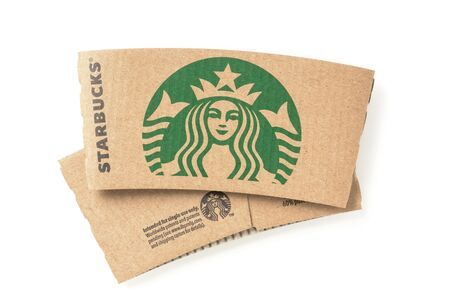 starbucks coffee: BANGKOK, THAILAND - FEBRUARY 04, 2015: Starbucks coffee cup sleeve on white background. Starbucks is the worlds largest coffee house with over 20,000 stores in 61 countries.