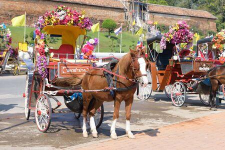 cartage: LAMPANG, THAILAND - DECEMBER 27, 2014: Horse carriage at Wat Phra That Lampang Luang in Lampang, Thailand.