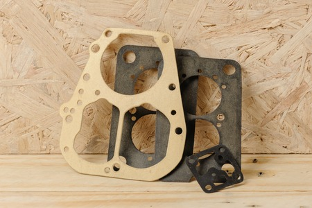 carburetor: closeup some carburetor parts on wooden desk Stock Photo