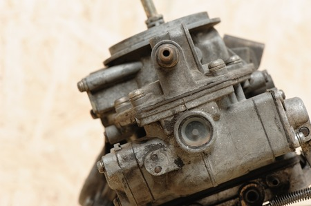 carburetor: closeup old and dirty carburetor on wooden desk Stock Photo