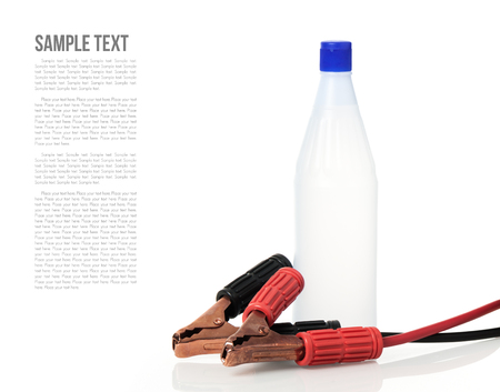 distilled: jumper cable and distilled water for car battery Archivio Fotografico