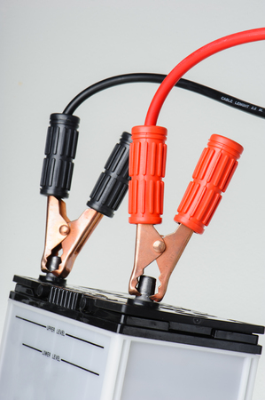 closeup car battery with jumper cable