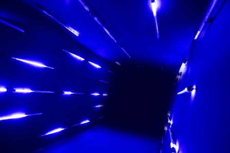 led lighting: tunnel going to the dark with blue LED lighting