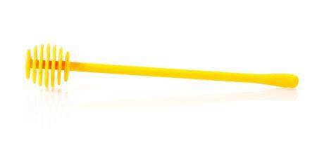 dipper: plastic honey dipper isolated on white background