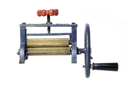 cast iron: old hand press machine for Sugar cane and Dry squid made from cast iron and brass Stock Photo