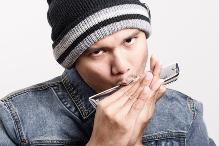 harmonica: young adult playing the harmonica