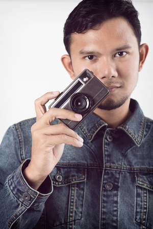 take a history: old vintage camera in hand