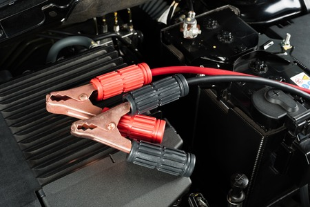 engine room: jumper cable for car battery in engine room Stock Photo
