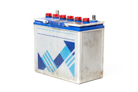 12v: closeup old car battery on white background