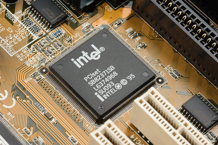BANGKOK, THAILAND - MARCH 05, 2015: Early microprocessor on motherboard from Intel. Intel is one of the world's largest and highest valued semiconductor chip makers. 報道画像
