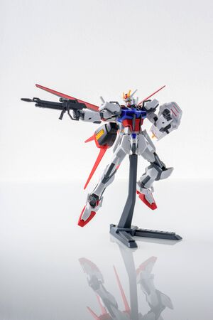 panoply: BANGKOK, THAILAND - MARCH 18, 2015: Plastic model of GAT-X105+AQME-X01 Aile Strike Gundam over white background.