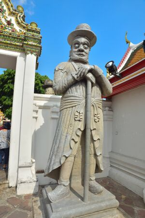 wat pho: BANGKOK, THAILAND - FEBRUARY 19, 2015: Statue of chinese man at Wat Pho in Bangkok, Thailand.
