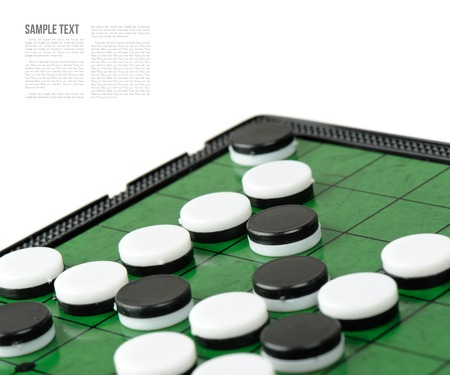 strategical: closeup discs on green Reversi board (Othello)
