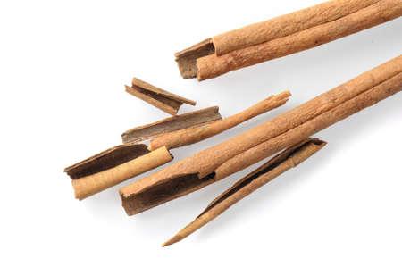 asian flavors: fragrant cinnamon sticks over white background Stock Photo