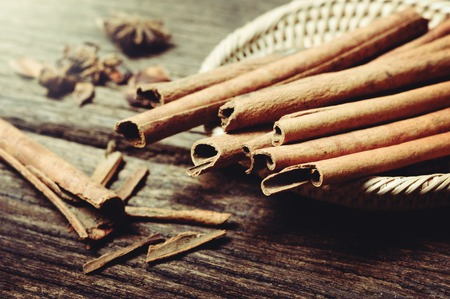 fragrant: fragrant cinnamon sticks over wooden desk Stock Photo