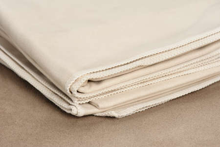 microfiber: closeup folded microfiber towel on brown leather background