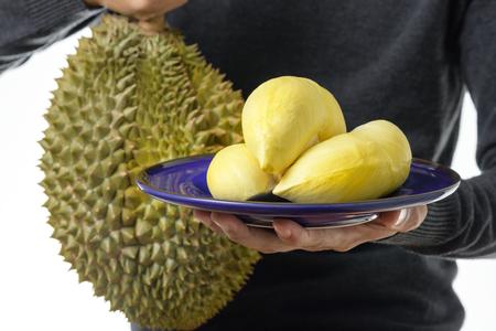 lobes: closeup yellow ripe Mon Thong durian lobes in plate. Stock Photo