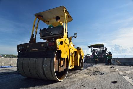 vibration: CHONBURI, THAILAND - MAY 21, 2015: Heavy Vibration roller at asphalt pavement works in Thailand. Stock Photo