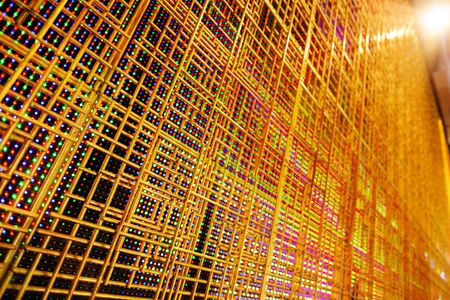 armature: abstract LED display with golden armature in the front