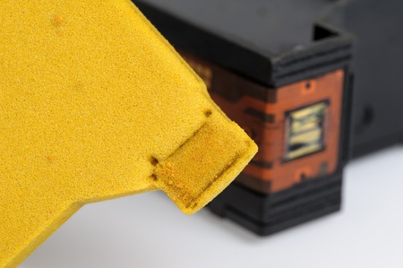 disassembly: closeup dirty yellow spong inside the ink cartridge Stock Photo
