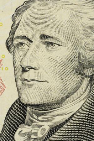 closeup Alexander Hamilton face on the US $10 dollar bill.