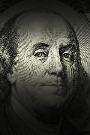 benjamin: closeup Benjamin Franklin face on the US $100 dollar bill.