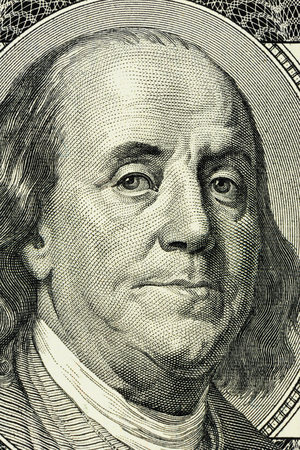 the franklin: closeup Benjamin Franklin face on the US $100 dollar bill.