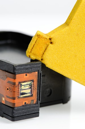 disassembly: closeup yellow spong inside the ink cartridge