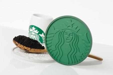 starbucks coffee: BANGKOK, THAILAND - APRIL 22, 2015: Starbucks Coaster 2014 made from Recycled Starbucks Coffee Grounds.