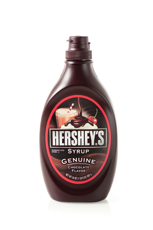 hershey's: BANGKOK, THAILAND - APRIL 26, 2015: A bottle of Hersheys Chocolate Syrup over white background. The Hershey Company is the largest chocolate manufacturer. Editorial