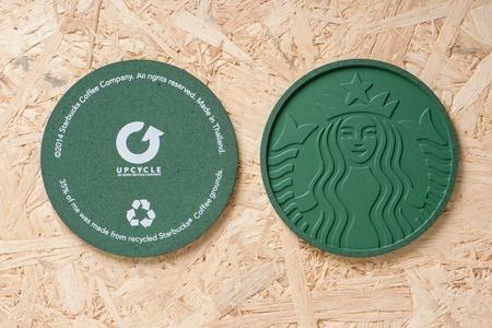 starbucks coffee: BANGKOK, THAILAND - APRIL 20, 2015: Starbucks Coaster 2014 made from Recycled Starbucks Coffee Grounds.