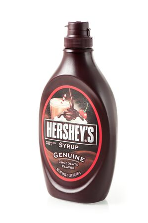 hersheys: BANGKOK, THAILAND - APRIL 26, 2015: A bottle of Hersheys Chocolate Syrup over white background. The Hershey Company is the largest chocolate manufacturer. Editorial
