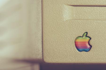 macintosh: BANGKOK, THAILAND - APRIL 29, 2015: Closeup old rainbow Apple logo on old Macintosh computer. Editorial