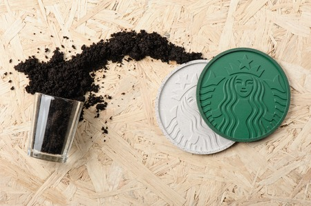 coffee grounds: BANGKOK, THAILAND - APRIL 22, 2015: Starbucks Coaster 2014 made from Recycled Starbucks Coffee Grounds.