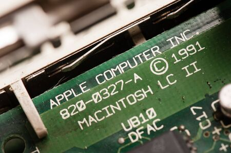 apple computer: BANGKOK, THAILAND - APRIL 29, 2015: Closeup word APPLE COMPUTER INC. on the old motherboard made by Apple Computer.