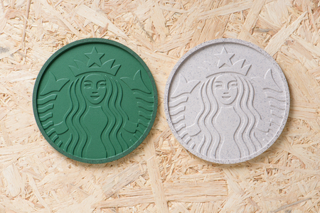 coffee grounds: BANGKOK, THAILAND - APRIL 20, 2015: Starbucks Coaster 2014 made from Recycled Starbucks Coffee Grounds.