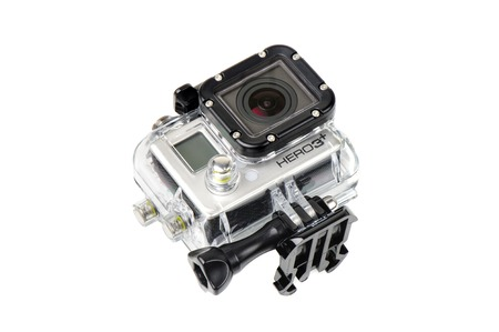 cam gear: BANGKOK, THAILAND - APRIL 01, 2015: GoPro HERO3+ Black Edition in housing isolated on white background. GoPro is a brand of cameras, often used in extreme action video photography.