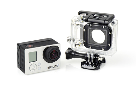 cam gear: BANGKOK, THAILAND - APRIL 01, 2015: GoPro HERO3+ Black Edition and housing isolated on white background. GoPro is a brand of cameras, often used in extreme action video photography. Editorial