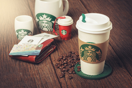 starbucks coffee: BANGKOK, THAILAND - APRIL 23, 2015: White paper cup and other gift with Starbucks logo. Starbucks is the worlds largest coffee house with over 20,000 stores in 61 countries.