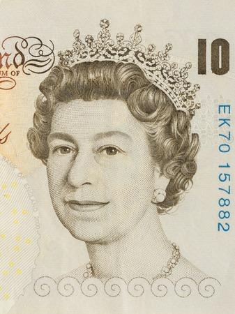 queen elizabeth ii: BANGKOK, THAILAND - JULY 13, 2015: Portrait of Her Majesty Queen Elizabeth II on England 10 Pound Sterling note