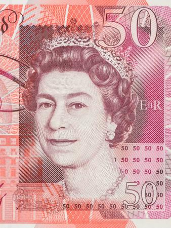 queen elizabeth: BANGKOK, THAILAND - JULY 13, 2015: Portrait of Her Majesty Queen Elizabeth II on England 50 Pound Sterling note