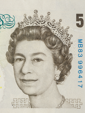 majesty: BANGKOK, THAILAND - JULY 13, 2015: Portrait of Her Majesty Queen Elizabeth II on England 5 Pound Sterling note Editorial