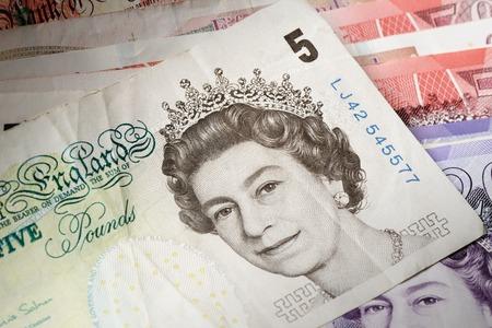 queen elizabeth ii: BANGKOK, THAILAND - JULY 13, 2015: Portrait of Her Majesty Queen Elizabeth II on England 5 Pound Sterling note Editorial