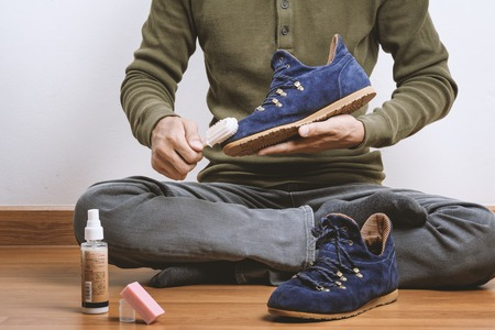 suede: The man cleaning his suede shoes