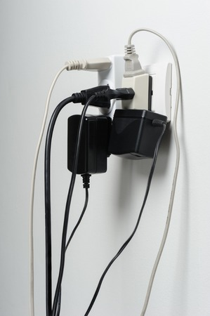 wire mess: Multiple electrical plugs in wall outlet