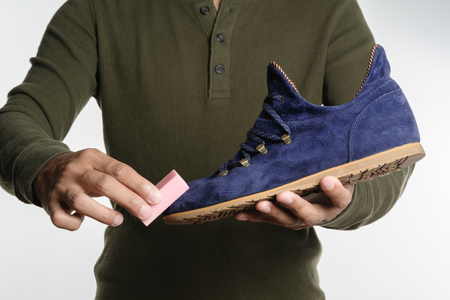 suede: The man cleaning his suede shoe Stock Photo