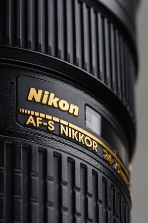 70 s: BANGKOK, THAILAND - MAY 13, 2015: Closeup Nikon logo on the Nikon 24-70mm f2.8G ED AF-S lens. This lens was announced in 2007 by Nikon, in Japan.