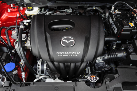 mazda: BANGKOK, THAILAND - MAY 20, 2015: Engine of All New Mazda 2 with SKYACTIV Technology. SKYACTIV is a brand name for a series of technologies developed by Mazda which increase fuel efficiency and engine output.