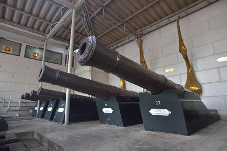gunnery: BANGKOK, THAILAND - FEBRUARY 19, 2015: Aancient cast iron cannons in Wat Phra Kaew temple in Bangkok, Thailand.